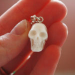 Hand carved bone skull necklace